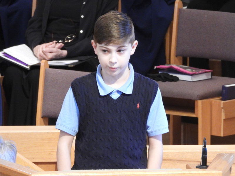A boy speaking to the congregation during Worship at the Kirk of Kildaire Presbyterian